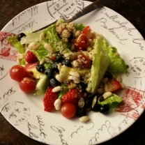 Taste of summer in January :) cherry tomatoes, sunflower seeds strawberries, blueberries great northern beans topped with hemp seed and honey mustard dressing.