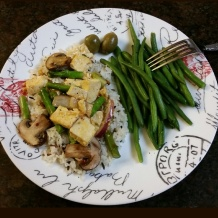 Trader Joe's basmati rice medley topped with tofu, mushrooms, asparagus, and red onions in a sweet chili sauce. Side of green beans and Greek green olives