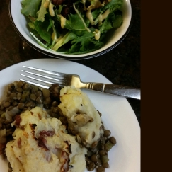 Lentil shepherds pie topped with red potatoes and parsnips with a spring mix side salad