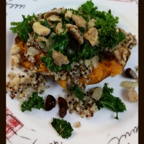 Baked sweet potatoes topped with sauteed onion, kale, dried cranberries, tri-colored quinoa, and walnuts