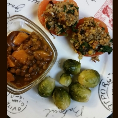 Stuffed tomatoes filled with a grain blend, dried cranberries, golden raisans, raisans, sunflower seeds, and a kale spinach blend. Side of brussel sprouts and baked beans and sweet potatoes.
