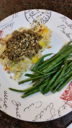 Mango Basmati rice with carrots, celery, leeks, and spices topped with lentils and sunflower seeds. A side of steamed green beans.
