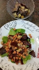 Beet, chickpea, tomatoe, and walnut salad on top of a bed of spring greens, with a side of sauteed mushrooms and leeks.