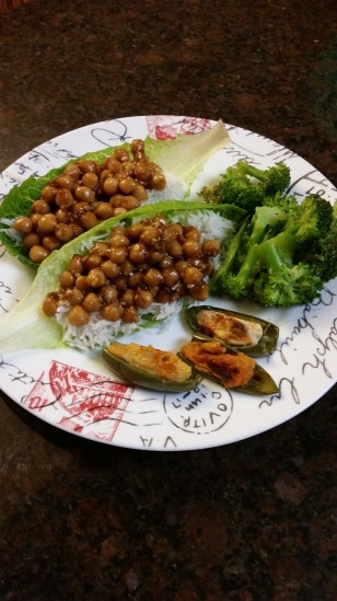 Lettuce wrapped Kung Pao chickpeas over a bed of rice, with a side of steamed broccoli and baked jalapeño peppers stuffed with hummus.